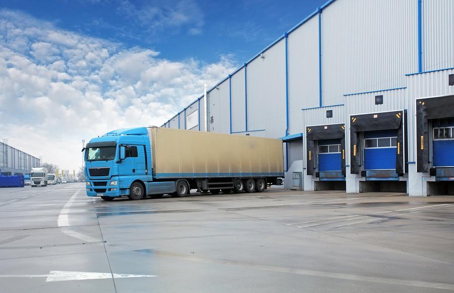 bigstock-Unloading-Cargo-Truck-At-Wareh-62742092.jpg