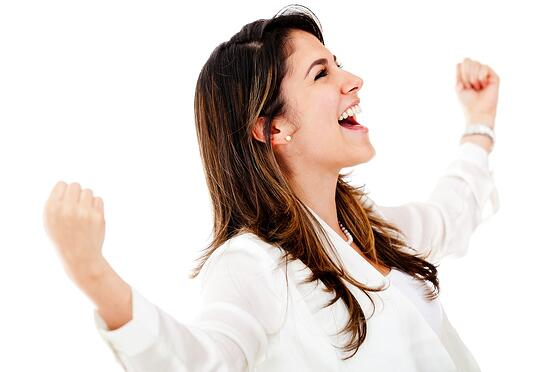 Successful business woman with arms up - isolated over a white background.jpeg