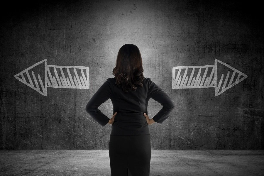 bigstock-Business-Woman-Has-To-Choose-B-100753106.jpg